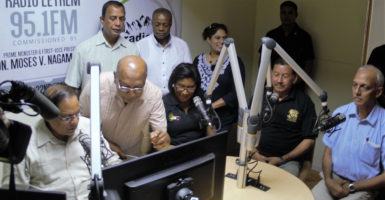 Prime Minister, Moses Nagamootoo (left) launching Radio Lethem 95.1 FM before the start of the programme yesterday. Also in photo are coordinator of the project, Rovin Deodat (second from left), Minister of Indigenous People's Affairs, Sydney Allicock, Minister of Public Communications, Cathy Hughes and Minister of Communities, Ronald Bulkan.