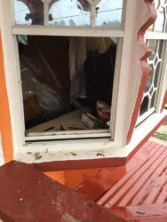 The window the bandits broke to enter