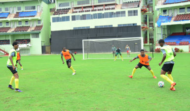 Members of the Golden Jaguars team going through an attacking drill at the National Stadium at Providence ahead of their clash with the Canadian Olympic team