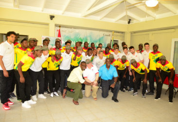 Canadian High Commissioner to Guyana Pierre Giroux, GFF Vice President Bruce Lovell and NSC Chief Christopher Jones shaking hands in solidarity while the members of the Golden Jaguars and Canada Olympic Team embrace.