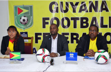 Guyana Football Federation President Wayne Forde (centre) addressing the gathering while Golden Jaguars Head-coach Jamaal Shabazz (right) and GFF Director of Communications Debra Francis looks on.