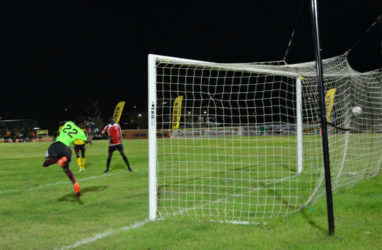 Julian Wade of Slingerz converting from the penalty mark during his helmet-trick against Monedderlust in the GFF Elite League at the Leonora Sports Facility. (Orlando Charles photo) pix saved as Slingerz1
