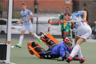 Guyana custodian Medroy Scotland dives in despair to try and stop an Argentina conversion during their match yesterday at the University of Toronto playing surface.