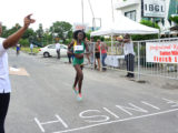 Claudrice McKoy about to cross the line to take the spoils on the distaff side of the inaugural 'Professional Key Shop and Wind Jammer Hotel Golden Mile'. (Orlando Charles photo)