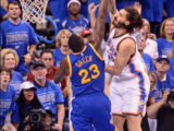 Draymond Green of the Golden State Warriors attempts to block the dunk attempt of Oklahoma Thunder's Steve Adams.