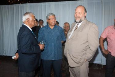 US Ambassador Perry Holloway (right) in conversation with businessman Sattaur Gafoor (left) and GuySuCo's Errol Hanoman.