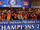 The Sunrisers Hyderabad players celebrate with the winning trophy of IPL 2016 after they narrowly defeated Royal Challengers Bangalore in  yesterday's final of the Indian Premier League at Chinnaswamy Stadium, Bengaluru.