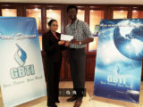 In Picture: Marketing Manager Ms. Pamela Binda and GLTA's President Jamal Goodluck with the sponsorship cheque.