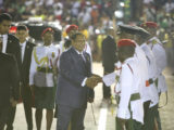 Prime Minister Moses Nagamootoo being greeted upon arrival at D'Urban Park last night.