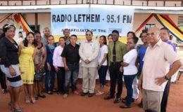 Prime Minister Moses Nagamootoo (centre) and project Coordinator Dr. Rovin Deodat (right) pose with young volunteer broadcasters after the official opening of Radio Lethem (GINA photo)