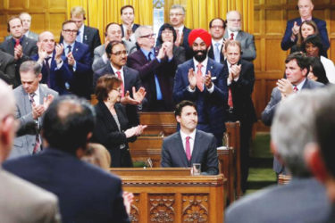 Canada's Prime Minister Justin Trudeau (seated) receives a standing ovation after delivering a formal apology for the Komagata Maru incident in the House of Commons on Parliament Hill in Ottawa, Canada yesterday. Reuters/Chris Wattie