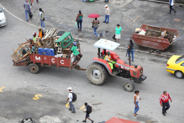 A Mayor and City Council tractor taking away the stalls from Stabroek Square