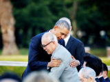 U.S. President Barack Obama (L) hugs an atomic bomb survivor Shigeaki Mori as he visited Hiroshima Peace Memorial Park in Hiroshima, Japan May 27, 2016. REUTERS/Carlos Barria