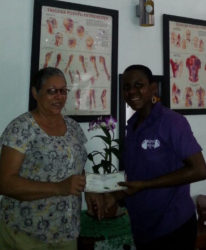 Sports Masseuse, Kathleen Paul handed over a gift certificate to Committee Member of the Powerlifting federation, Andrea Smith recently.
