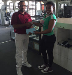 A Buddy's Gym representative presents the cheque to GAPF Secretary, Melissa Tucker.
