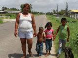 Taking a walk along the Essequibo Coast Public Road: Naomi Fredericks with nephew Lerone, niece Chelsea, and son Romel