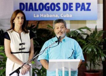 Revolutionary Armed Forces of Colombia (FARC) negotiator Marcos Carratala reads a document next to Colombian government spokeswoman Marcela Duran in Havana, Cuba June 22, 2016. Reuters/Enrique de la Osa
