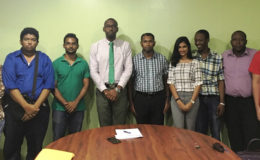 Director of Sport Christopher Jones and President of the Guyana Chess Federation Irshad Mohammed (centre) stand with some members of the 2016 Guyana Olympiad chess team. The team travels to Baku, Azerbaijan, for participation at the Olympiad in September. A signature qualifying tournament was not held to determine the members of Guyana's Olympiad chess team.