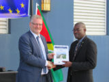 European Union Ambassador Jernej Videtič (left) hands over the Coastal Engineering Design Manual for Guyana Sea and River Defences to Minister of Public Infrastructure David Patterson. (Ministry of Public Infrastructure photo)