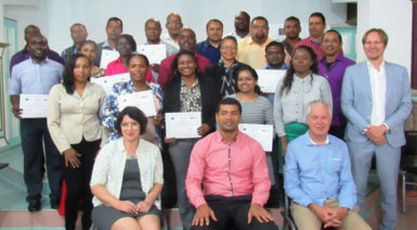 Trainers and participants at the training session