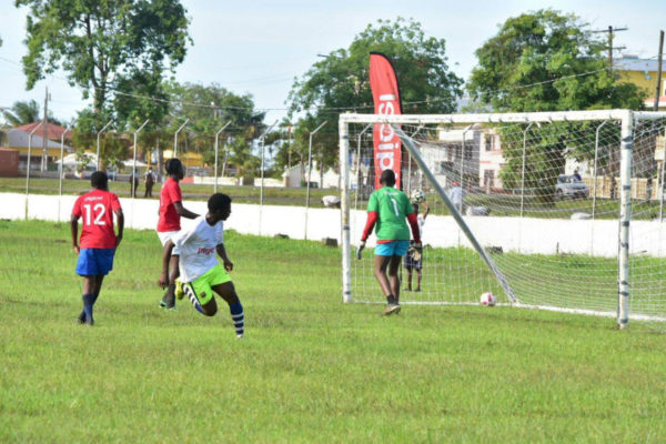A Bishops' High School player scores against Tutorial High during their meeting at the Camp Ayanganna ground in the Digicel Schools Football Championships yesterday.