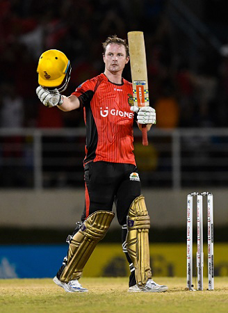 Trinbago Knight Riders' Colin Munro celebrates his maiden T20 hundred on Saturday night. (Photo courtesy CPL)