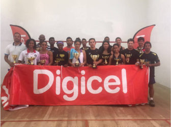 The respective division winners in the GSA sanctioned Digicel Senior Squash Championships pose with their spoils following the conclusion of the event at the Georgetown Club Facility yesterday.