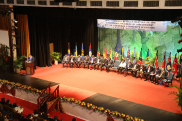 Caricom Heads on stage at the National Cultural Centre last evening as their 37th  regular  meeting opened.