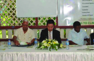 From left at head table are Minister of Agriculture Noel Holder; Japanese Ambassador to Guyana  Mitsuhiko Okada and Chief Executive Officer of the National Drainage and Irrigation Authority, Frederick Flatts (GINA photo)