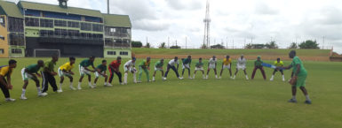 FLASHBACK! National U17 Coach Garvin Nedd doing catching drills with the team during their first day of training at the Guyana National Stadium prior to the regional U17 tournament.(Clifton Ross photo)