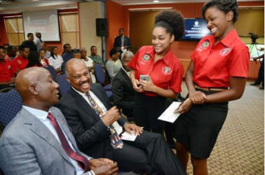 Dr Keith Rowley (left), prime minister of Trinidad and Tobago, and Professor Sir Hilary Beckles, vice chancellor of the University of the West Indies, chat with Kennika Johnson (second right), secretary of the Guild of Students, and Sherica Taylor, public relations officer, Guild of Students.