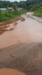 "One section of the Matarkai Road that has been reduced to a ""slush dam"" according to a resident."