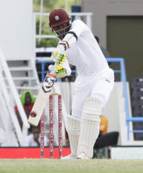 Batsman Marlon Samuels drives during his half-century against India on the fourth day of the opening Test on Sunday. (Photo courtesy WICB)