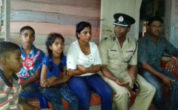 Commander of 'B' Division Ian Amsterdam (second, right) meeting with Pawan Chandradeo's wife and children