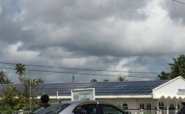 The roof of Nand Persaud International Communications Inc at Tain covered with solar panels