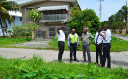 Community Coordinator, Ministry of Public Infrastructure, Neilson McKenzie, Deputy Mayor, Sherod Duncan, Councillor Alfred Mentore, Councillor Phillip Smith and Councillor Akeem Peter assessing the drainage at Bel Air Park (GINA photo)