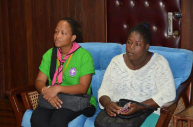 Mothers of the two injured Cub Scouts (left) Jacqueline Matthew and (right) Delia Finistere listen intently to President David Granger, during the meeting this morning. (Ministry of the Presidency photo)