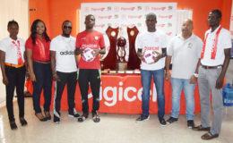 Captain of Wismar/Christianburg Keshawn Dey (4th from left) and skipper of Chase Academy Jeremy Garrett (3rd from right) posing alongside the championship trophy while Wismar/Christianburg coach Delon Peters (3rd from left) and Chase Academy owner Henry Chase (2nd from right) and Digicel Representatives look on.