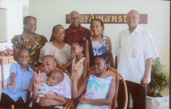 Family portrait: From left (back row): Daughter Dr Vivienne Mitchell-Amata, wife Stella, Dr Gladstone Mitchell, daughter Sonia an attorney in Jamaica and son-in-law Dr Andrew Amata. And in the front row are his grandchildren: Clemson, Raphael, Harlen, Debra and Ariande.