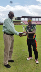 MVP Shemaine Campbelle accepts her MVP trophy from Match Referee Grantley Culbard.