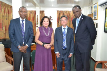 First Lady, Mrs. Sandra Granger is flanked by, from L-R : Dion Inniss, Caribbean Airlines' Guyana and Suriname Sales Representative; Tyrone Tang, Chief Executive Officer and Carl Stuart, South America Manager. (Ministry of the Presidency photo)