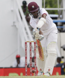 Opener Kraigg Brathwaite defends a delivery during his top score of 74 on the third day of the opening Test against India yesterday. (Photo courtesy WICB)