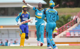 23 July 2016; Zouks captain Daren Sammy (C) celebrates the wicket of Ahmed Shahzad (out of shot) as Andre Fletcher (R) completes the catch and Kyle Hope (L) looks on during Match 22 of the Hero Caribbean Premier League St Lucia Zouks v Barbados Tridents at the Daren Sammy Cricket Stadium in Gros Islet, St Lucia. Photo by Ashley Allen/Sportsfile