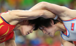 Zhong Xuechun of China and Jong Myong-Suk of North Korea compete in women's freestyle 53kg wrestling. REUTERS/Toru Hanai