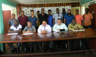 Executives of the GCB (front row, seated) flanked by some of the Guyana Jaguars senior franchise players following the Jaguars 3-Day franchise launch.