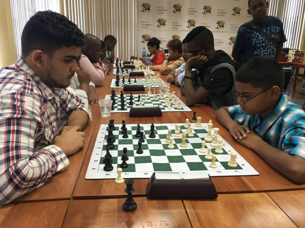 Roberto Neto, 19, (left) is a member of the 2016 Guyana Olympiad chess team. A newcomer to the game, he enjoyed some robust successes by defeating the senior and junior national champions on occasion. Although he only began playing the game in 2010, Neto has been competing regularly in tournaments and has become a prominent fixture in competitions. In this photograph, he faces St Stanislaus' student Gansham Alijohn in a recent tournament.