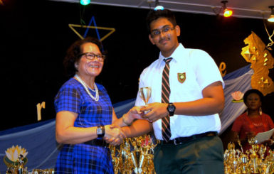 Khishan Singh receiving a prize from First Lady Sandra Granger at the Bishops' High School Prize Giving ceremony earlier this year.