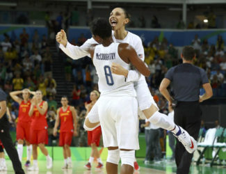 Diana Taurasi of the U.S. hugs team mate Angel McCoughtry after winning the gold in basketball. REUTERS/Jim Young