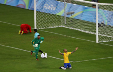 Neymar of Brazil celebrates with goalkeeper Weverton after they won the penalty shootout and the gold medal. REUTERS/Leonhard Foeger