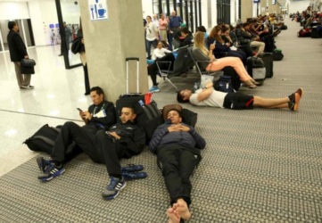 Passengers wait for their flights at Galeao International Airport at the conclusion of the Rio Olympics in Rio de Janeiro, Brazil yesterday. (Reuters/Mariano Bazo)